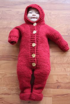 Knitted baby jumpsuit. Drops pattern.