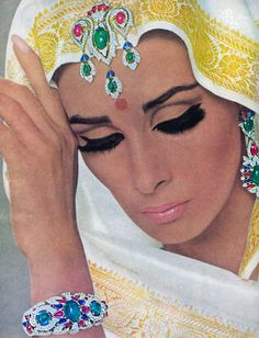 Wilhelmina modeling Cartier jewelry.French Vogue,August 1965.