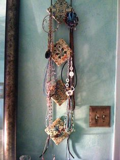 made a necklace jewelry rack from a plate rack!
