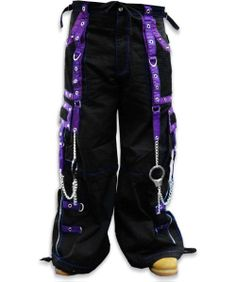 "Tripp NYC ""Death Row"" Bondage Pants Feature deep front pockets oversized back pockets and decorated cargo pockets and have enough storage to fit all your goodies and baddies."