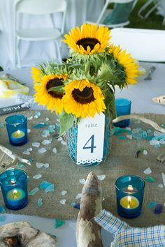 Sunflower centerpiece with varying shades of blue - burlap runner.