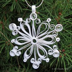 Quilling-I used to do this a lot, it is very fun and oh, so, easy!!