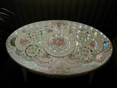 Love this table. So exquisite mosaic  with china and iridescent glass.
