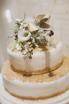 wedding cake with a dusting of gold sugar, photo by Katie Purnell http://ruffledblog.com/intimate-irish-wedding #weddingcake #cakes #gold