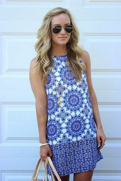 Cute This Blue and White Printed Sleeveless Mini Dress With handbag