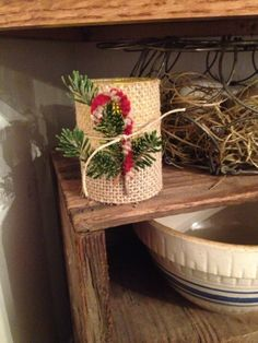 Burlap votive with a primitive candy cane and tree sprig tied with twine. The Duncan's.