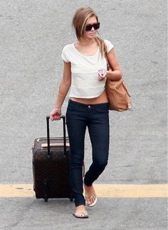 Audrina Patridge. Simple. and i want her LV luggage
