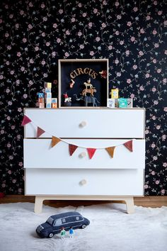 Beautiful Children's nursery - white dresser with black floral wallpaper and playful accents #socialcircus