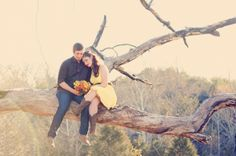 I love this picture! I want to take a picture like this at my wedding...now to find the right tree:)