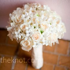 White bouquet of roses, ranunculus, orchids and stephanotis with crystal pin accents // Laura Novak Photography // Bouquet: Evantine Design // http://www.theknot.com/weddings/album/a-formal-wedding-in-wilmington-de-85792