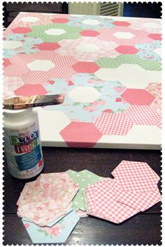 "Paper Hexagon ""quilt"" by lesley zellers, via Flickr made a hexagon template with clear vellum and cut out the shapes from six different sets of paper. Then I arranged them on a huge canvas and glued them down with decoupage. Click to link to actually see the paper quilt"