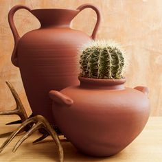 Turn plastic garden containers into old Terra Cotta Planters