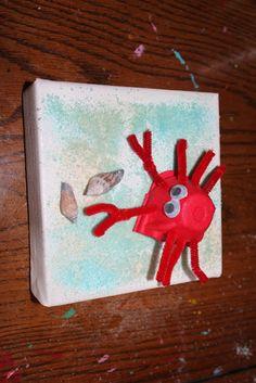 Egg carton crab craft with colored salt sand.