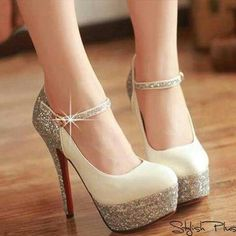 Gorgeous cream and sparkly shoes with a beautiful red sole!