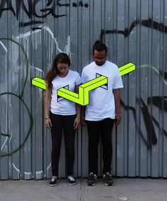 Aakash Nihalani's neon shapes pierce human torsos in Brooklyn