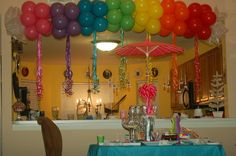Rainbow party decorations - different coloured balloons always make great decorations plus you could use then for games & the kids can take them home too balloon party ideas, birthday idea, rainbow balloons, rainbow balloon arch, kids birthday parties at home, rainbow kids birthday party, kid parties, parti idea, balloon arch decorations