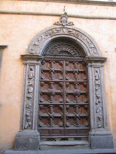 Door of Bishop's Palazzo in Lucca. Italy