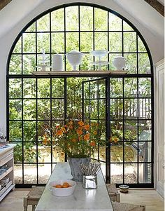 I would have a window/wall like this in my kitchen...