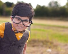 BAHH such a precious little child in a bow tie and oversized glasses.