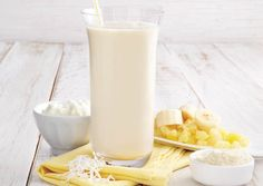 Piña Colada Protein Shake Ingredients ◦1 cup low-fat cottage cheese ◦1 cup crushed pineapple, drained, or ◦1 cup pineapple juice ◦½ frozen banana ◦½ cup skim milk ◦1 tbsp shredded coconut ◦½ scoop vanilla whey protein powder ◦1 cup ice cubes Nutritional Breakdown: 49% carbs, 41% protein, 10% fat. Cal - 210 Fat - 2.5g Carbs  - 25g Protein - 22g
