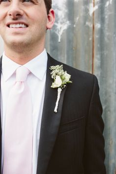 rose and babys breath boutonniere for Groom! http://www.weddingchicks.com/2013/10/21/industrial-wedding-2/