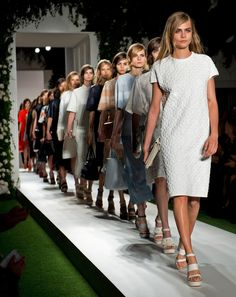 Cara Delevingne leads the final walk on the Mulberry catwalk for the SS14 show at London Fashion Week.