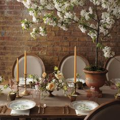 Decorate the space above the tables in a high-ceilinged wedding reception,