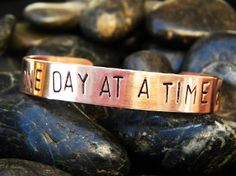 One Day at a Time bracelet in Copper Inspirational gifts for cancer patients, survivors and their loved ones.  20% of profits from this campaign goes to cancer research.  Use code CANCERSUCKS at http://shop.purplepelicandesigns.com for free standard US shipping through 11/30/2013