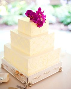 Square buttercream-frosted cake