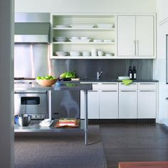 With open shelving, stay monochromatic. Piles of all-white dishes never look messy.