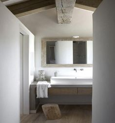 modern rustic bathroom,,,,beam, mirror, sink.....