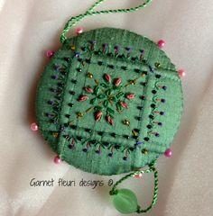Embroidered Pin Wheel / Pincushion by Garnetfleuri