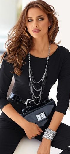 Irina Shayk.. like this black simple outfit w/touches of patent leather and silver accessories.