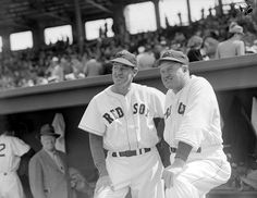(l to r:) Boston Red Sox Johnny Murphy and manager Joe Cronin on dugout steps at Fenway Park in 1947.