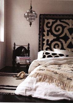 Suzani wall covering behind bed