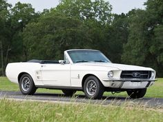 1967 Ford Mustang Convertible. These are some of my favorite cars, especially this year(1967)