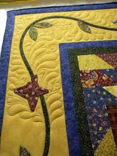Love the feather quilting around the vine for the border! Sewkindofwonderful.blogspot.com