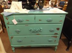 SOLD - 3 Drawer chest with metal drawer pulls - painted in a turquoise color & distressed.***** In Booth H13 at Main Street Antique Mall 7260 E Main St (east of Power RD on MAIN STREET) Mesa Az 85207 **** Open 7 days a week 10:00AM-5:30PM **** Call for more information 480 924 1122 **** We Accept cash, debit, VISA, MasterCard or Discover.