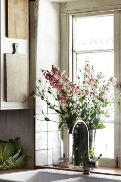 natural light and fresh flowers always make a room look bigger