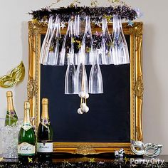 Amaze with a DIY champagne flute chandelier! New Years Eve Party Ideas in Black and Gold