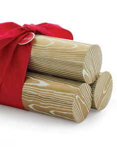 Yule Log Gift Packaging    Here's an attractive way to package unusually shaped gifts, such as glassware or bottles: Put them in mailing tubes dressed up as Yule logs.