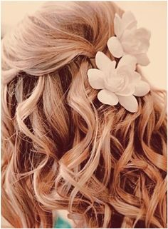 Great idea for a simple and elegant beach wedding look...Dress to Impress with Gorgeous Wedding Hairstyles for Long Hair! #maui #wedding  Beautiful. Love that the 'gritty' waves are softened with a soft volume at the crown and kissed with a couple roses. Lovely balance of naughty and nice ;-)