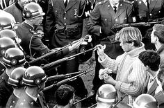 """This is where the name """"flower child"""" and the phrase """"flower power"""" came from. Anti-war protesters would stick flowers in the barrels of guns of the police to demonstrate peace."""