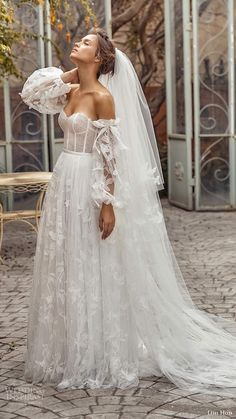 lihi hod fall 2020 bridal detached sheer long balloon sleeves sweetheart neckline fully embellishe lace ball gown a line wedding dress chapel train (6) sv -- Lihi Hod Fall 2020 Wedding Dresses | Wedding Inspirasi #wedding #weddings #bridal #weddingdress #weddingdresses #bride #fashion #collection: White Blossom #label: Lihi Hod #season: Fall/Winter #week: 422019 #year: 2020 ~ | Pin discovered by Kelly's Closet bridal boutique in Atlanta, Georgia