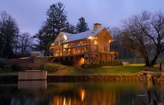 Barn home by pond.