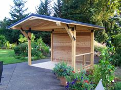 covered deck ideas | Small solid patio cover design with blue roof.