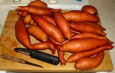 Fresh sweet potatoes, washed and ready for canning