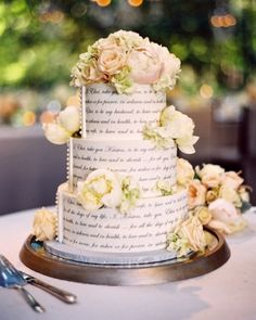This three-tiered cake was adorned with the couple's vows and fresh flowers