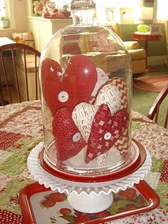 So sweet - hearts under glass - love the cloche on the milkglass cake plate