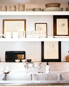 White floating shelves above a kitchen sink